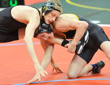Black River's Sebastian Vidika, right, grabs the leg of Jake Adkins of Johnstown Northridge in the state semifinal match. DAVID RICHARD