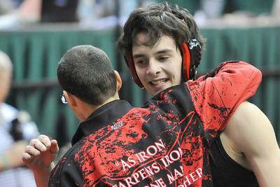 Lutheran West's Jake DeLorge celebrates his consolation round win with coach Dave Ressler. DAVID RICHARD / CHRONICLE