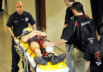 Elyria's Matt Canon is taken to an ambulance after suffering an apparent concussion during his 120-pound match in the championship bracket yesterday against Uniontown Lake's Zac Carson. DAVID RICHARD / CHRONICLE