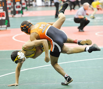Massillon Washington's Ivan McClay takes down Mark Matos of Amherst yesterday in a 120-pound match in Div. I in Columbus. DAVID RICHARD / CHRONICLE
