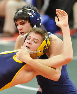 Tom Zeigler, front, of Cleveland St. Ignatius tries to get out of a hold by Lancaster's Jacob Spearman in a 113-pound match in Div. I. DAVID RICHARD / CHRONICLE