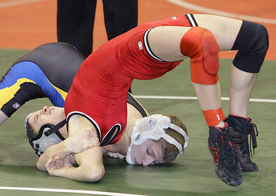 Crestwood's Paige Nemec avoids a pin against Olentangy's Trevor Fiorucci at 103lbs in the first round of the Division 2 State Wrestling Tournament in Columbus. Nemec is the first female wrestler to qualiify for the state tournament. (RON SCHWANE / CT)