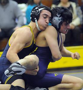 North Ridgeville's Will Keller, left, defeats Avon's Austin Matsko in the 126-weight class. STEVE MANHEIM/CHRONICLE