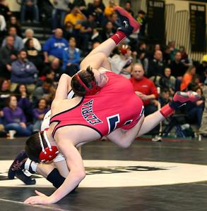 Wadsworth's Noah Baughman takes down Elyria's Josh Breding during the 120lb. semi-finals at the Perrysburg District tournament. (RON SCHWANE / GAZETTE)