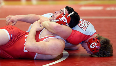 Wadsworth's Michael North prepares to pin Steven Carder from Perry during their championship match at 145 lbs.  AARON JOSEFCZYK / GAZETTE