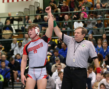 Wadsworth's Michael North raises his arm in victory over Olmsted Falls' Josh Jaeckin during their Championship match at 145 lbs. AARON JOSEFCZYK / GAZETTE