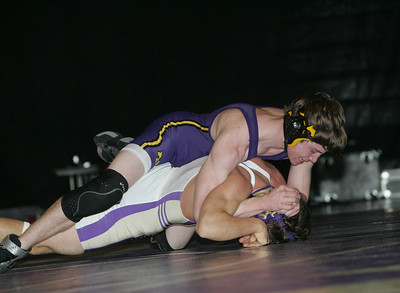 Adam Barker of Avon (140) in solid purple, top, wrestles Vermilion's Ben Safer. Barker would go on to win.  photo by Chuck Humel