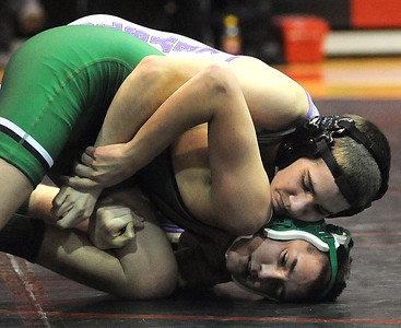 Keystone, top, defeats Columbia in the 113 weight class. STEVE MANHEIM/CHRONICLE