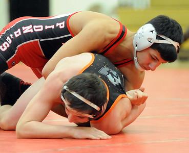 Elyria's Nico O'dor defeats Ashland's Landon Plank in the 132-pound weight class. STEVE MANHEIM/CHRONICLE