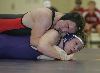 27JAN11  Firelands Chuck Sees in Black and Red wrestling Avon's Brandon Blakely in the 171 pound class.  photo by Chuck Humel