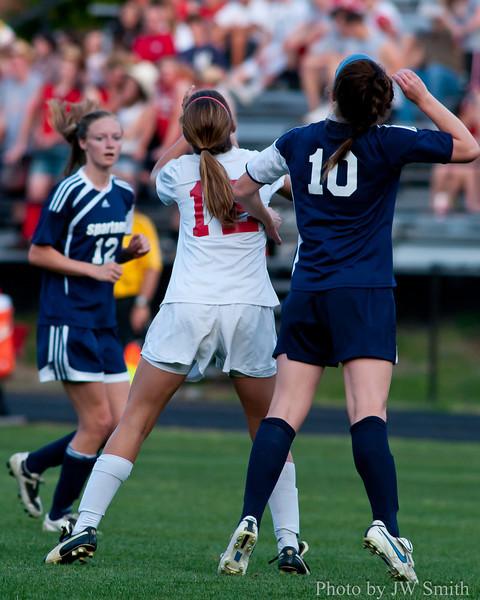 Melanie Norton heads the ball to Jordan Walker.