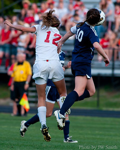 Melanie Norton heads the ball to Jordan Walker.