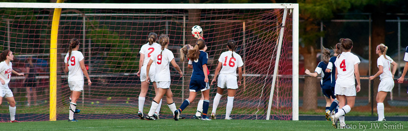 Goalkeeper Kristen Ahearn collects a corner kick.