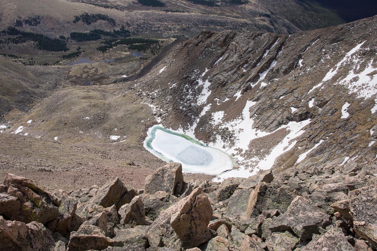 Frozen lake below us on the eastern side of the peak.