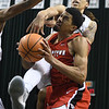 Eric Bonzar—The Morning Journal<br> Youngstown State's Devin Haygood is fouled on his way to the basket by Cleveland State's Jamarcus Hairston, Jan. 1, 2018.