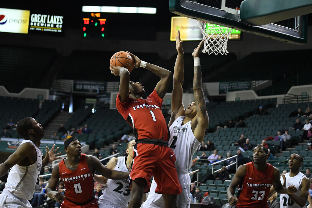 . Eric Bonzar�The Morning Journal<br> Youngstown State guard Braun Hartfield (1) shoots over Cleveland State defender Anthony Wright (2), Jan. 1, 2018.