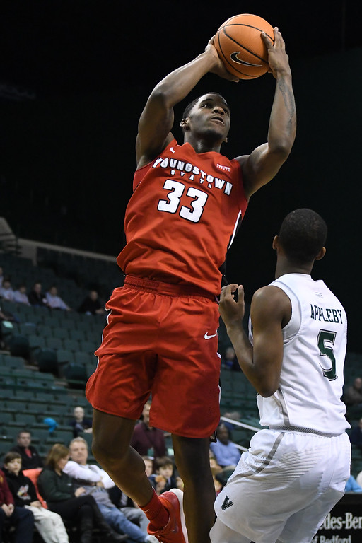 . Eric Bonzar�The Morning Journal<br> Youngstown State forward Naz Bohannon shoots a jumper over Cleveland State\'s Tyree Appleby, Jan. 1, 2018.