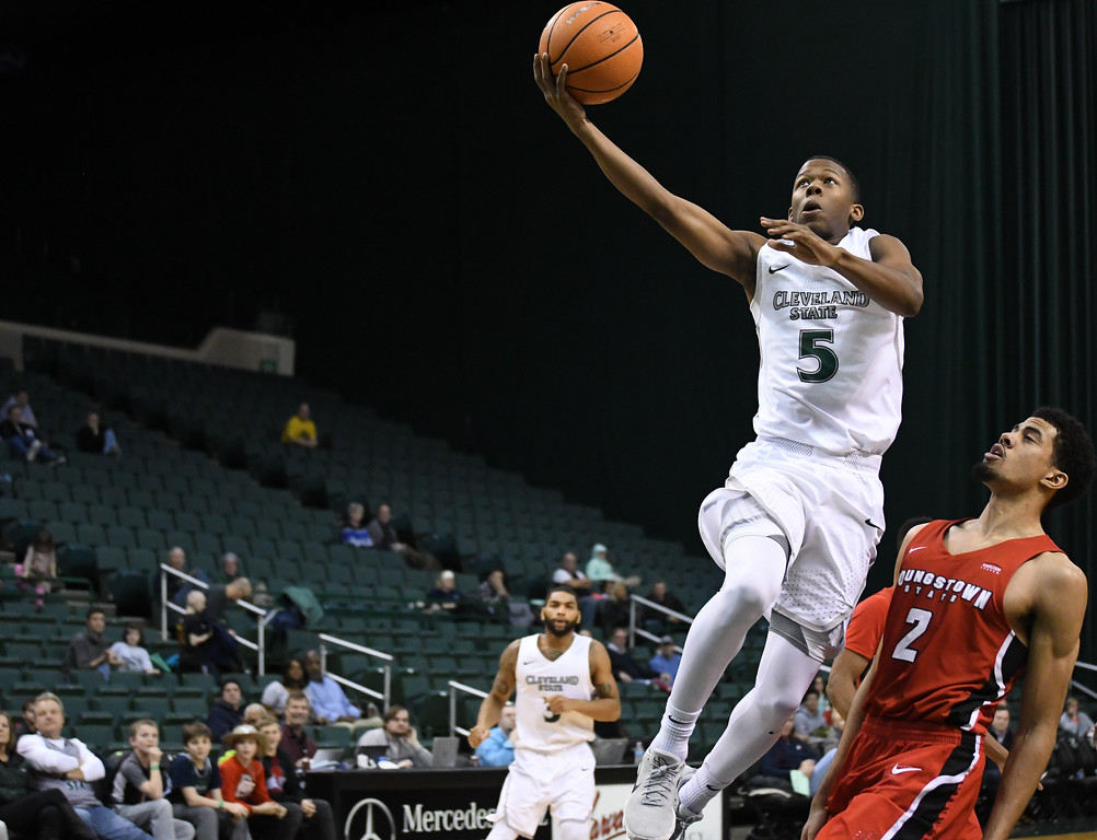 . Eric Bonzar�The Morning Journal<br> Cleveland State\'s Tyree Appleby (5) gets by Youngstown State forward Devin Haygood (2) for a basket in the second half, Jan. 1, 2018.
