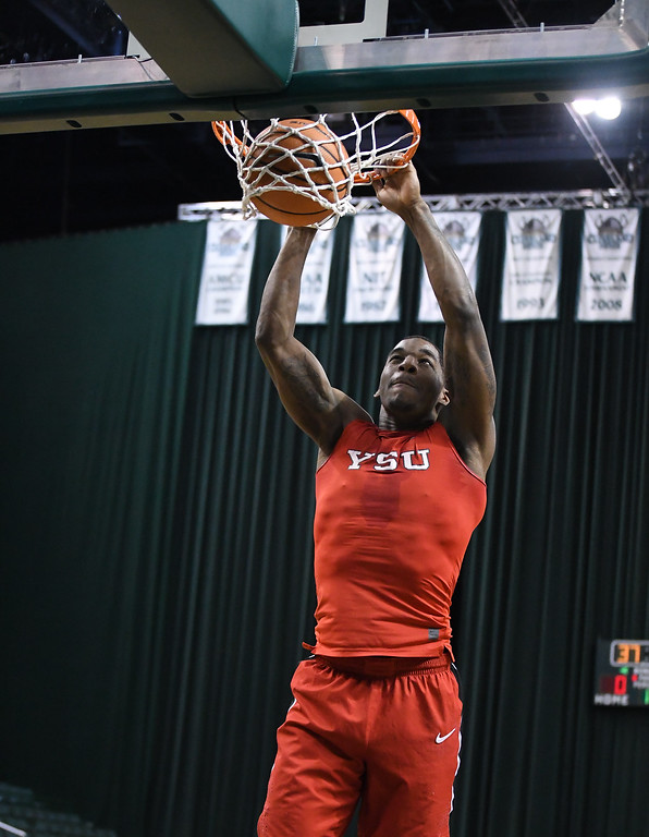 . Eric Bonzar�The Morning Journal<br> Lorain High School graduate and Youngstown State University freshman Naz Bohannon throws down a dunk, during warm ups, prior to the start of the Penguin\'s Horizon League game against the Cleveland State Vikings, Jan. 1, 2018. The Penguins improved to 3-11 with a 80-77 win over the Vikings.