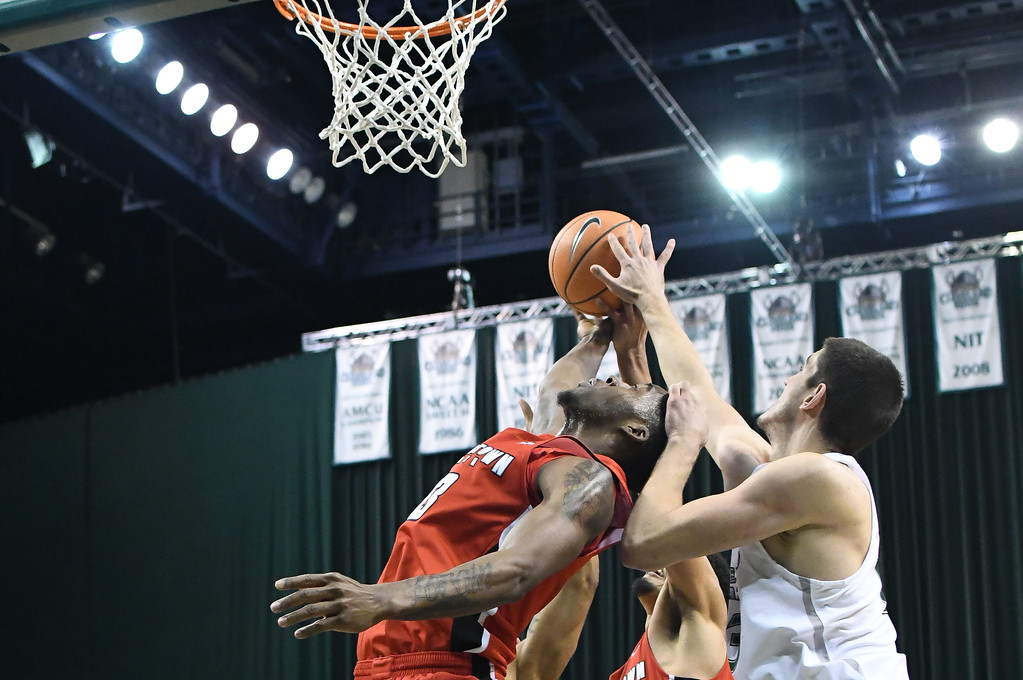 . Eric Bonzar�The Morning Journal<br> Cleveland State\'s Stefan Kenic and Youngstown State\'s Naz Bohannon battle for a rebound, Jan. 1, 2018.