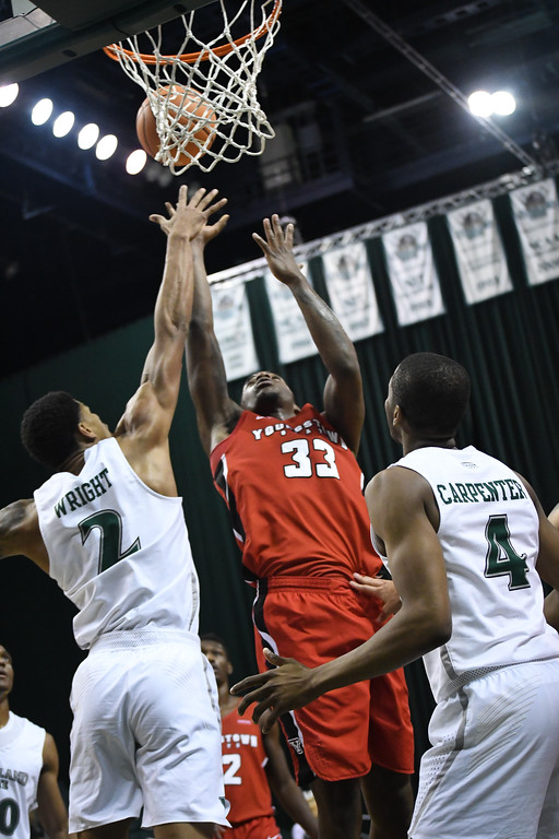 . Eric Bonzar�The Morning Journal<br> Youngstown State\'s Naz Bohannon battles for a rebound over Cleveland State\'s Anthony Wright (2), Jan. 1, 2018.