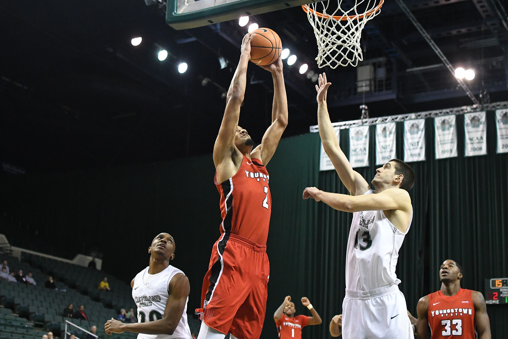. Eric Bonzar�The Morning Journal<br> Youngstown State\'s Devin Haygood (2) shoots over Cleveland State\'s Stefan Kenic (13), Jan. 1, 2018.