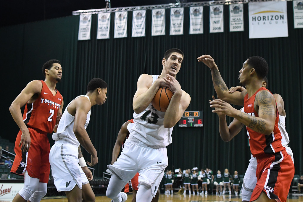 . Eric Bonzar�The Morning Journal<br> Cleveland State\'s Stefan Kenic pulls in a rebound, Jan. 1, 2018.