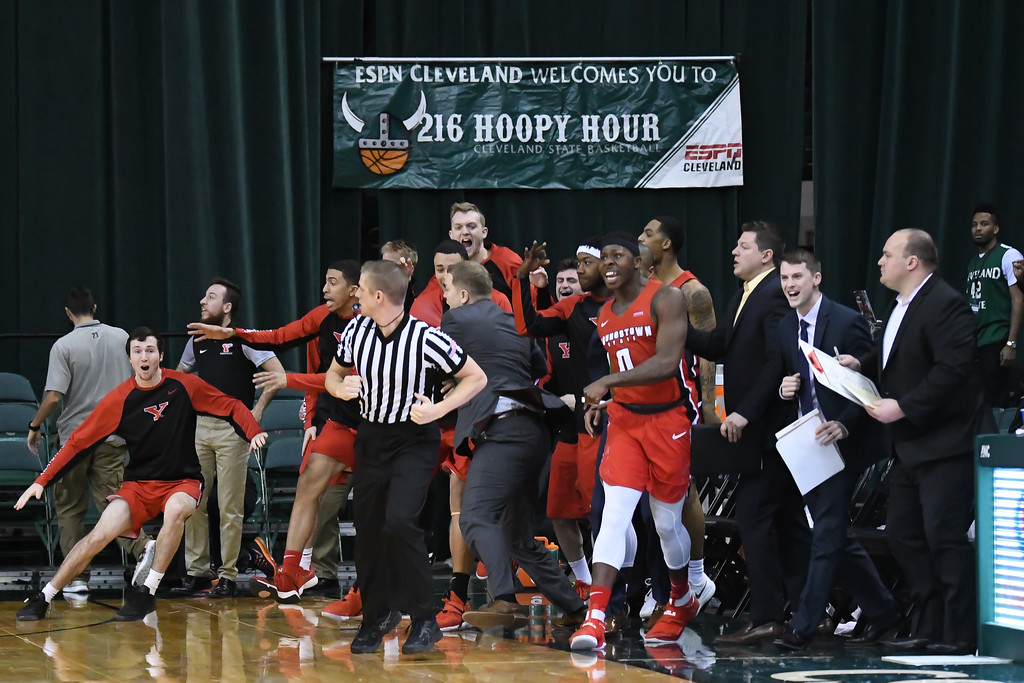 . Eric Bonzar�The Morning Journal<br> The Youngstown State bench reacts after guard Cameron Morse sinks a 3-point basket with six-tenths of a second left in the game. The Penguins would go on to beat the Cleveland State Vikings, 80-77, Jan. 1, 2018.