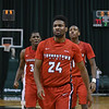 Eric Bonzar—The Morning Journal<br> Flanked by forward Naz Bohannon, left, and guard Braun Hartfield, right, Youngstown State's Cameron Morse (24) struts to the other end of the court after sinking a 3-point basket with six-tenths of a second left in the game. The Penguins would go on to beat the Cleveland State Vikings, 80-77, Jan. 1, 2018.