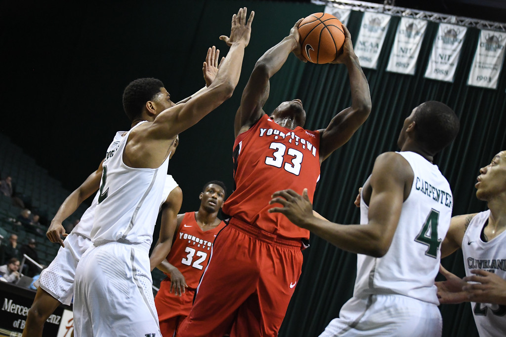 . Eric Bonzar�The Morning Journal<br> Youngstown State forward Naz Bohannon pulls in a rebound, Jan. 1, 2018.