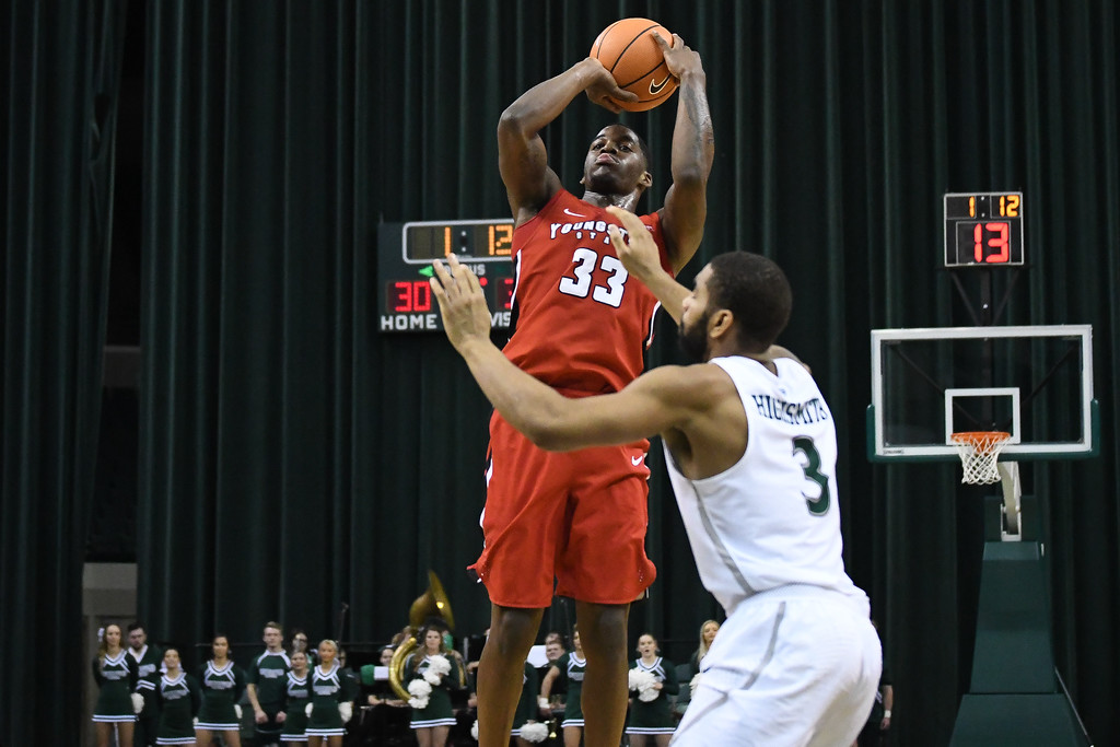 . Eric Bonzar�The Morning Journal<br> Youngstown State forward Naz Bohannon shoots a jumper over Cleveland State\'s Dontel Highsmith, Jan. 1, 2018.