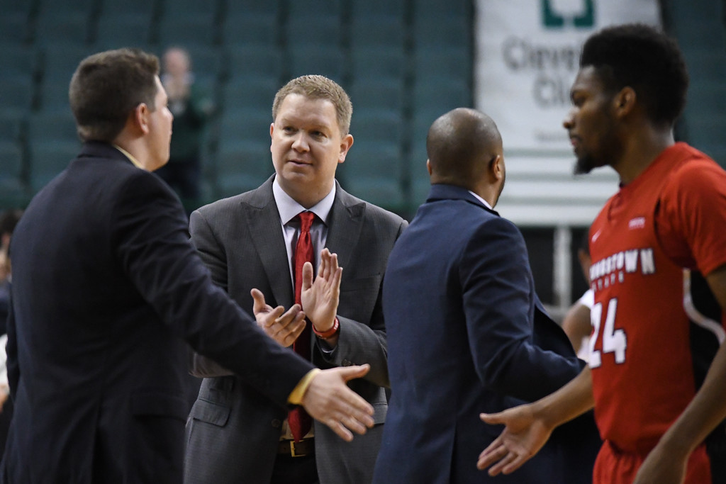 . Eric Bonzar�The Morning Journal<br> Youngstown State Head Coach Jerrod Calhoun applauds his team during a timeout, Jan. 1, 2018.