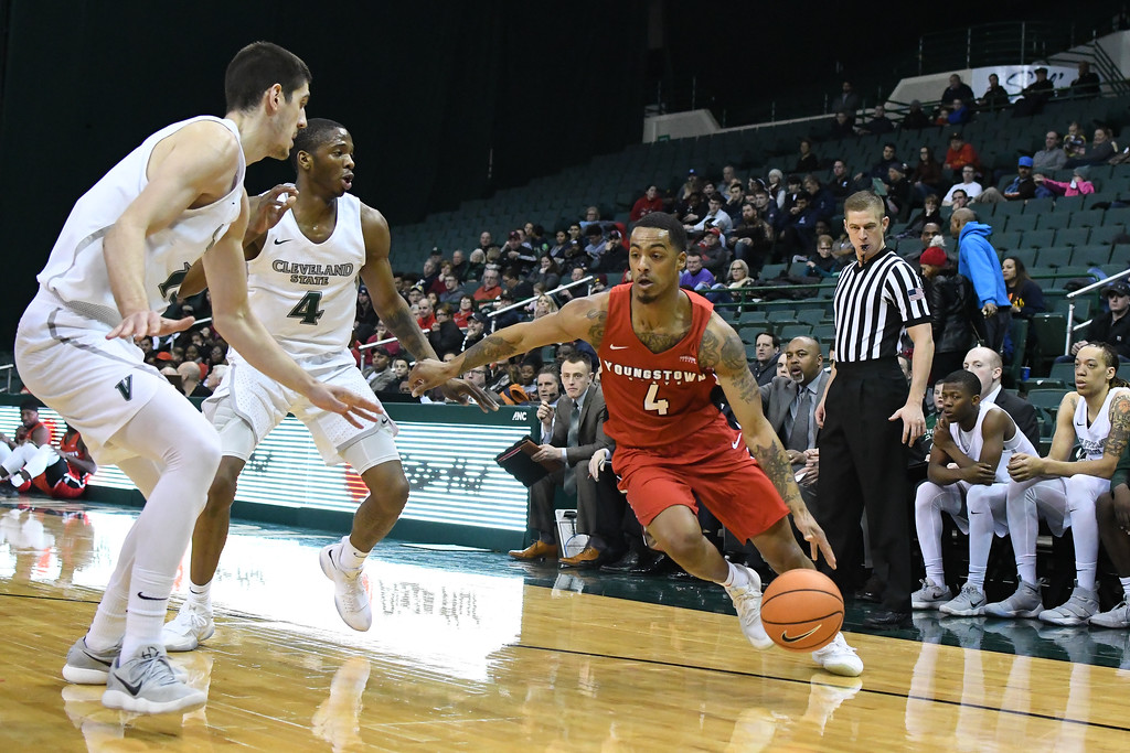 . Eric Bonzar�The Morning Journal<br> Youngstown State\'s  Jaylen Benton (4) dribbles around the Cleveland State defense of Stefan Kenic and Kenny Carpenter (4),  Jan. 1, 2018.