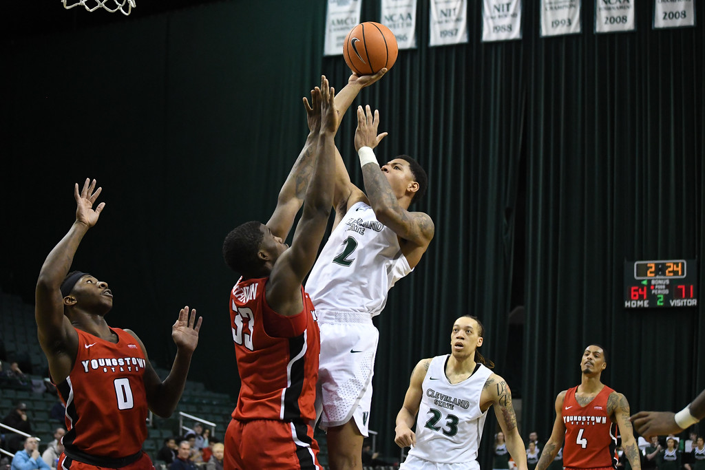 . Eric Bonzar�The Morning Journal<br> Cleveland State\'s Anthony Wright (2) shoots over Youngstown State forward Naz Bohannon (33).