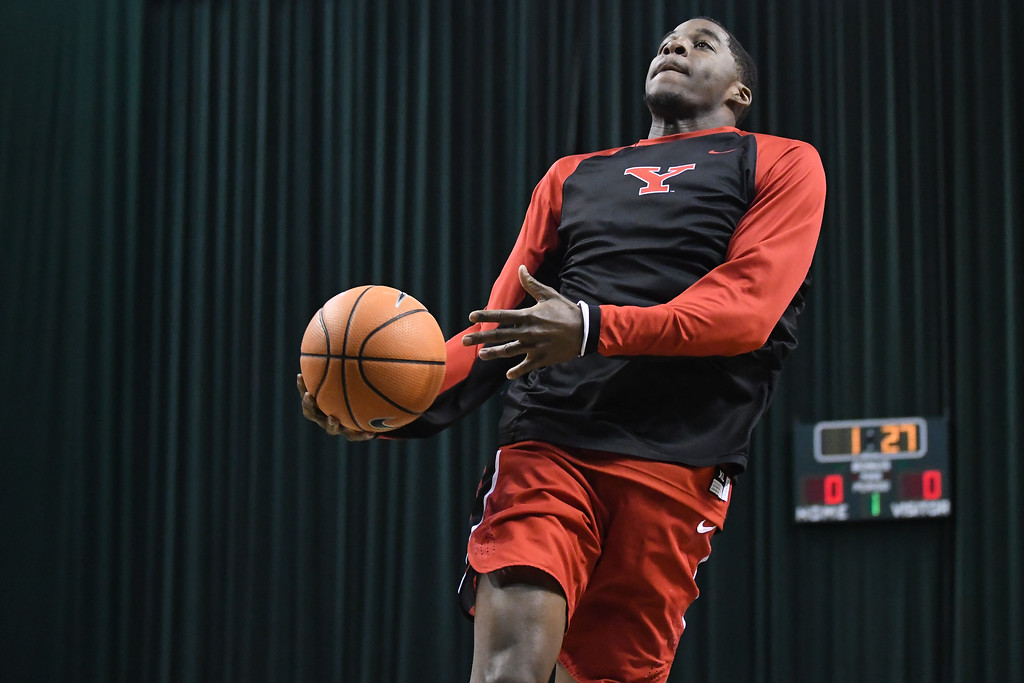 . Eric Bonzar�The Morning Journal<br> Lorain High School graduate and Youngstown State University freshman Naz Bohannon warms up prior to the start of the Penguin\'s Horizon League game against the Cleveland State Vikings, Jan. 1, 2018. The Penguins improved to 3-11 with a 80-77 win over the Vikings.