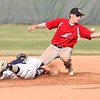 Ironmen second baseman Turner Mudrock loses the ball on a play at second as Charles Easton of the Bulldogs dives back safely on Monday.