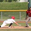 Ironmen first baseman Robert Williams looks the throw in as Brandon Talion reaches back safely on Monday.