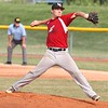 Zach Straley of the Ironmen delivers a pitch during the third inning against the Bulldogs on Monday.