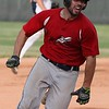 Luke Corrola of the Ironmen rounds third base and will score during the first game against the Bulldogs on Monday.