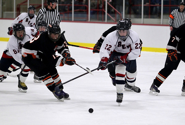 Record-Eagle/Keith King <br /> The Bay Reps' Luke McDiarmid, right, and Cheboygan's Jordan Yost battle for control of the puck Wednesday, February 16, 2011 at the Kaliseum in Kalkaska.