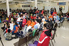 Audience for prize draws at Thomas Cheechoo Jr. Memorial Complex Community Hall as part of Hockey Development Camp