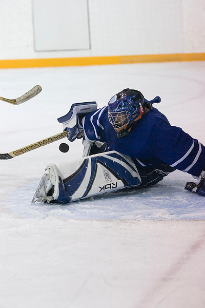 Rodney Hookimaw, goalie of the Moosonee Bombardiers makes a save.