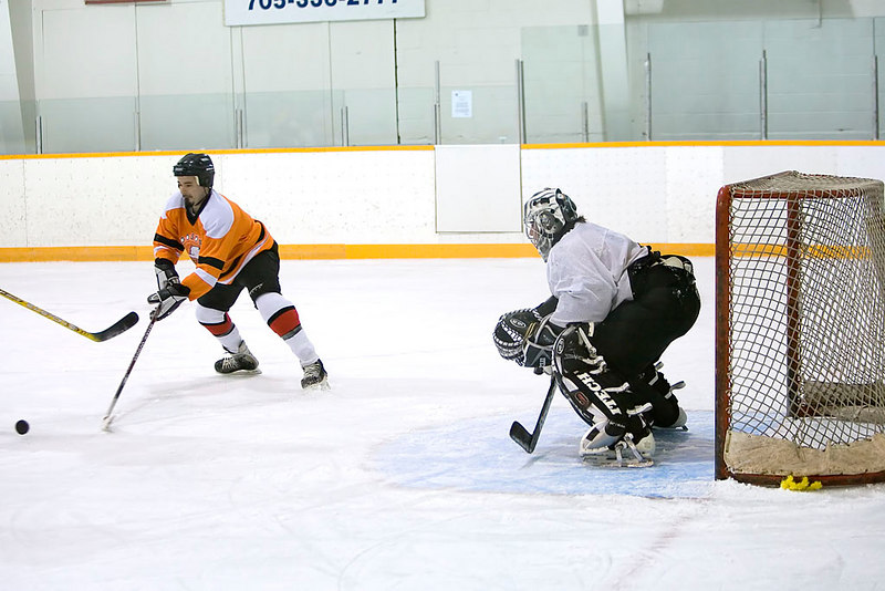 Clint Hamilton of the Polar Bears protects his own net with Todd Reuben in goal.