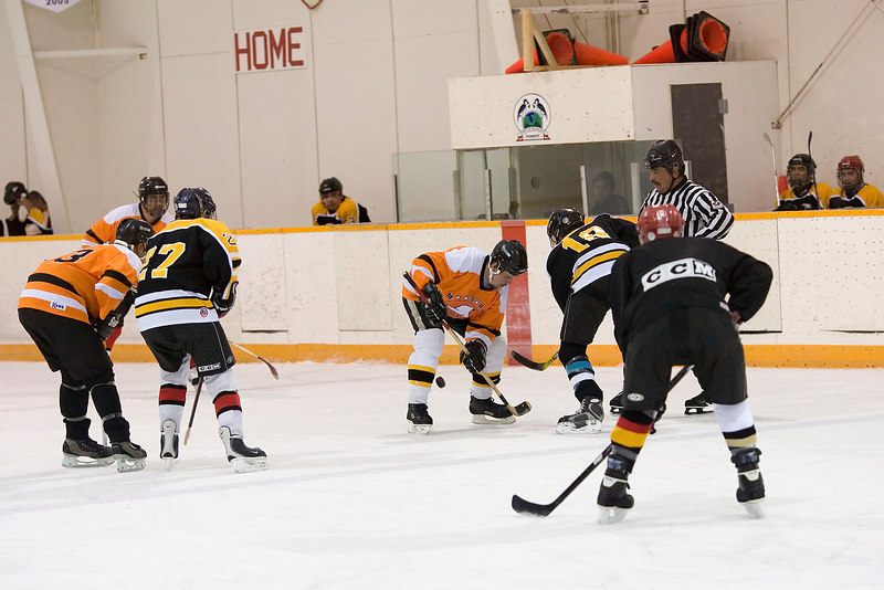 Russell Williams (18) of the Bombardiers faces off with Aaron Morrison of the Polar Bears, with a two man advantage to the Polar Bears.