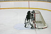 Note that there is already a puck in the net. Not the one in play.