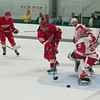 Record-Eagle/Jan-Michael Stump<br /> Red Wings right wing Jamie Tardif (29) gets stopped by goalie Jimmy Howard. The Detroit Red Wings ended training camp with Tuesday's Red vs White game at Centre ICE Arena.