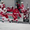 Record-Eagle/Jan-Michael Stump<br /> Red Wings' center Francis Pare (59) skates past defenseman Logan Pyett (22).The Detroit Red Wings ended training camp with Tuesday's Red vs White game at Centre ICE Arena.