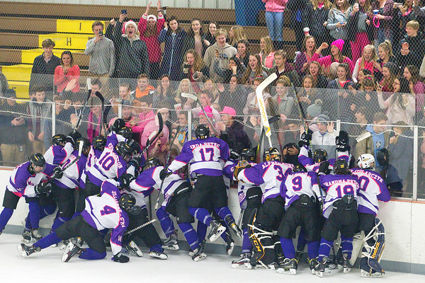 Record-Eagle/Jan-Michael Stump<br /> Traverse City Central players celebrate their 4-2 win over Traverse City West with fans Wednesday at Howe Arena.