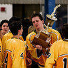 Record-Eagle/Pete Rodman<br /> Traverse City Central's Rhys Adle, center, holds up the Jeff McCullough Memorial Cup after the team defeated Traverse City West 2-1 in overtime at Howe Arena on Wednesday.