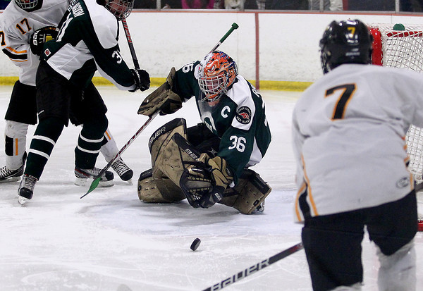 Record-Eagle/Keith King<br /> Grand Rapids West Catholic goalie, Adam Rooney (36) eyes the puck against Traverse City Central Monday, February 25, 2013 in Howe Arena at the Grand Traverse County Civic Center.